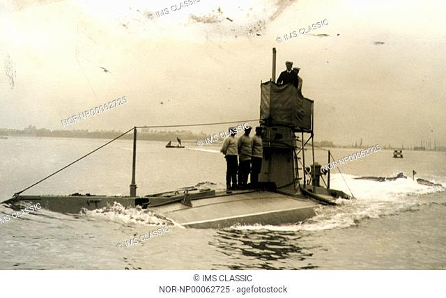 Men standing on a mostly submerged submarine