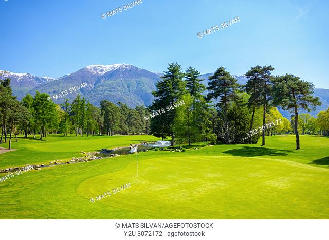 Hole 8 in Golf Club Ascona with Trees and Mountain in Ticino, Switzerland