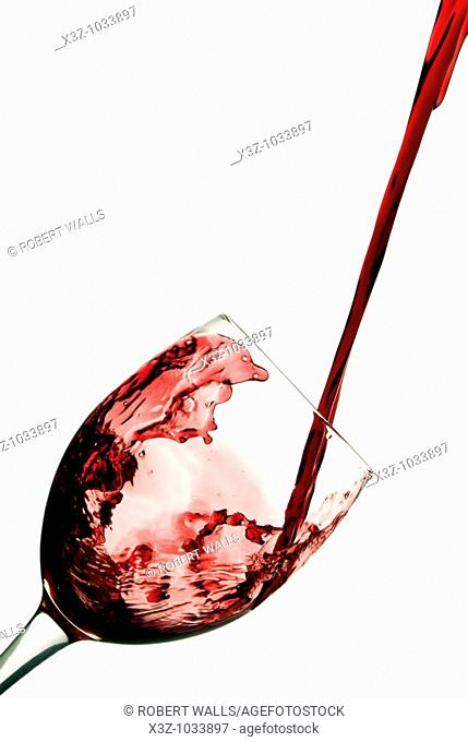 Red wine splashing into wine glass