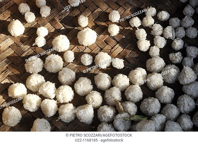 Ubud (Bali, Indonesia): rice balls, left to dry under the sun, to be used as offerings to the spirits by Hindu believers
