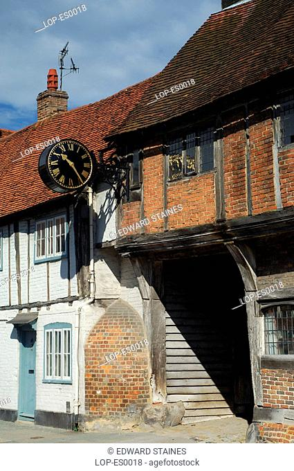 England, Buckinghamshire, West Wycombe, West Wycombe clock and village. West Wycombe village is owned by the National Trust