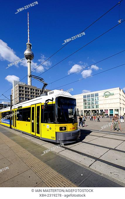 View of Alexanderplatz with yellow tram in Mitte Berlin Germany