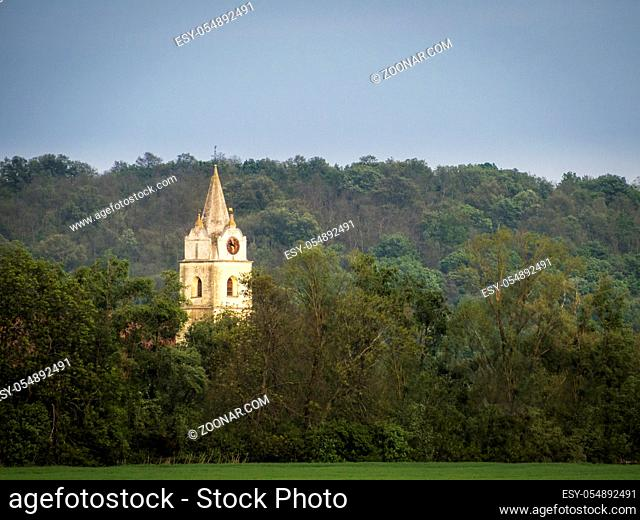 Belltower of a Church in woodland