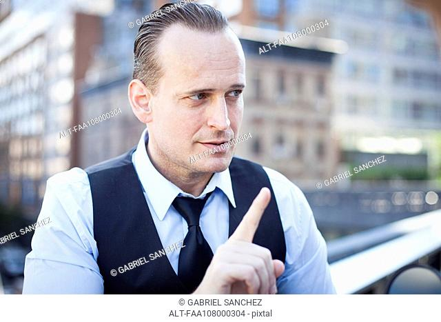 Businessman gesturing with finger