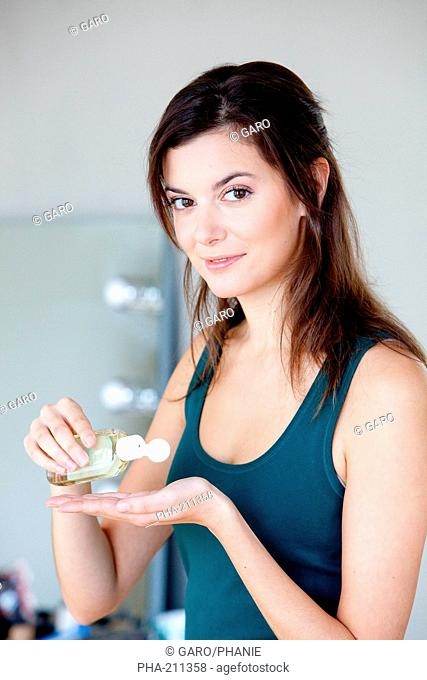 Woman washing her hands with hydroalcoholic gel