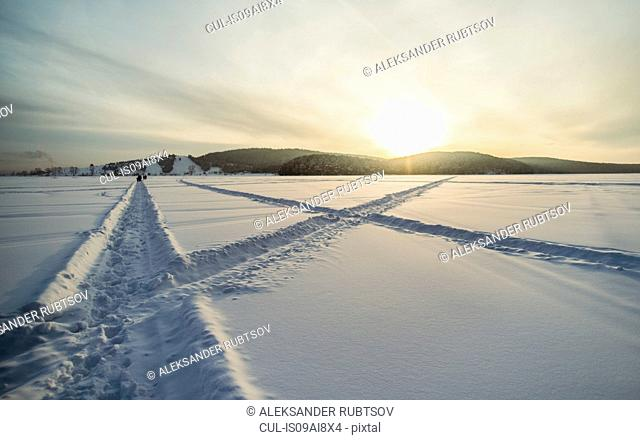 Snow covered landscape at sunset, Russia