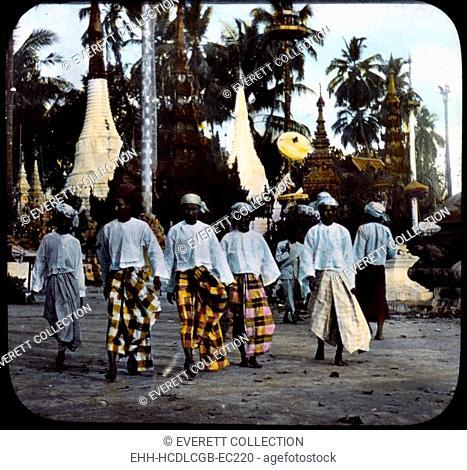 Burma, men walking on street, hand colored lantern slide, photograph by William Henry Jackson, 1895