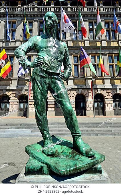 Antwerp / Antwerpen, Belgium. City Hall / Stadhuis (1565: Flemish Renaissance) in the Grote Markt (main square) Statue: De Buildrager (Dock worker - Constantin...