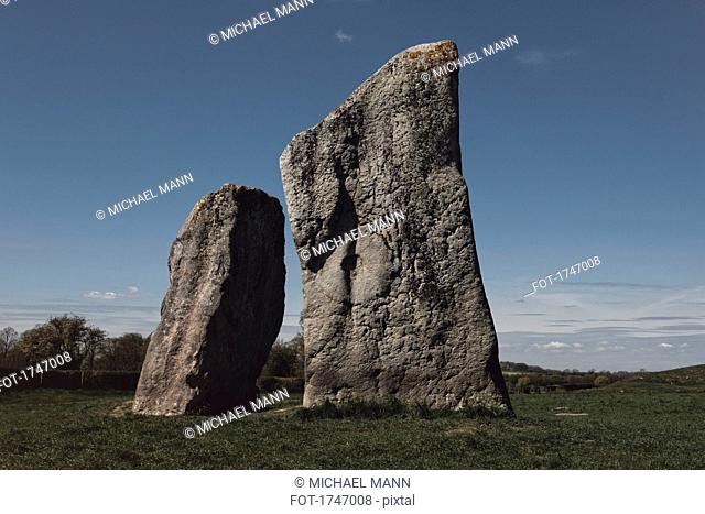 Standing stones in field against sky, Avebury, Wiltshire, United Kingdom