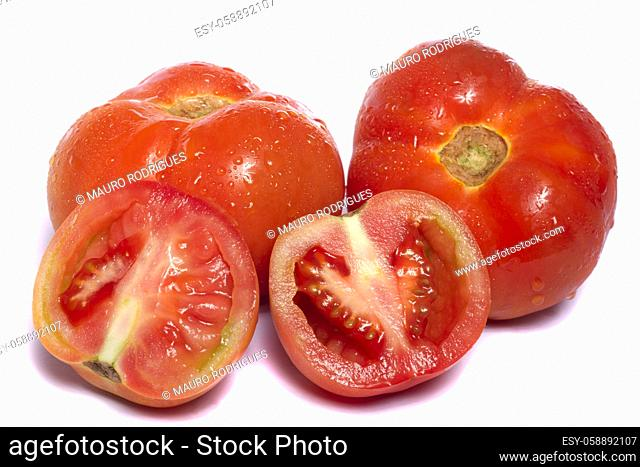 Close up view of a bunch of red tomatoes isolated on a white background