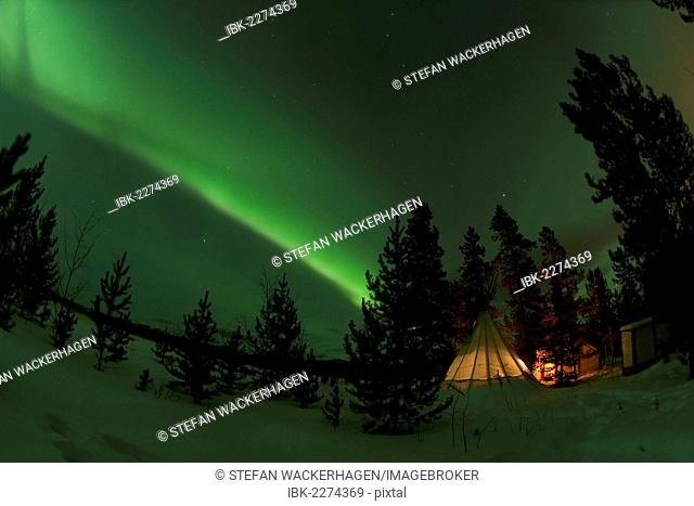Illuminated, lit teepee, tipi, tepee, Northern polar lights, Aurora Borealis, green, near Whitehorse, Yukon Territory, Canada