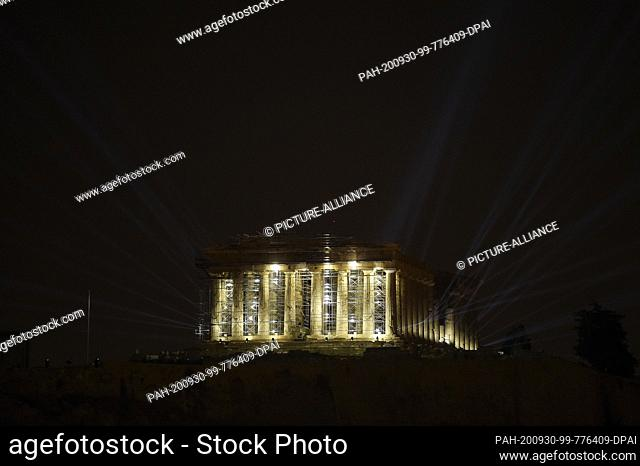 30 September 2020, Greece, Athen: The Acropolis shines in a new light: a new lighting system has been inaugurated by the Ministry of Culture at the...