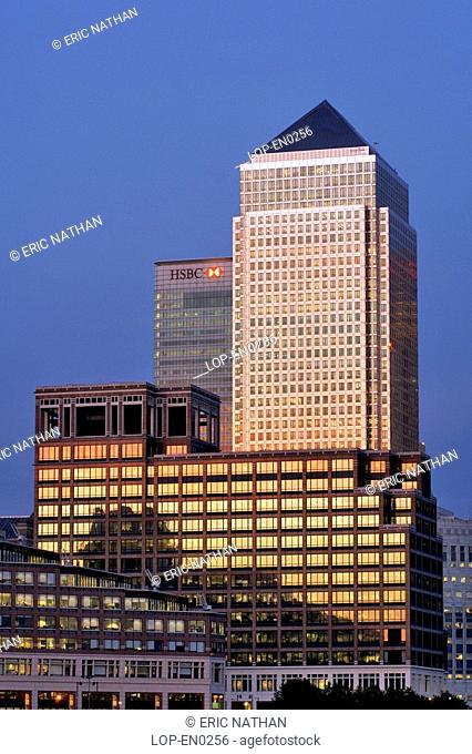 England, London, Canary Wharf, Dusk view of Canary Wharf Tower and other buildings in the docklands on the Isle of Dogs. Canary Wharf Tower is the tallest...