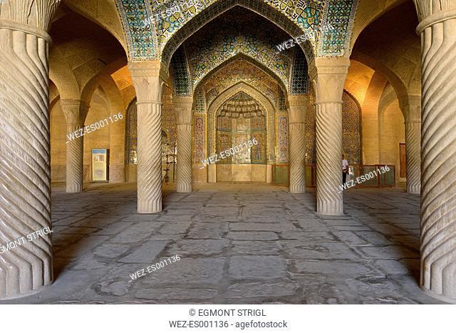 Iran, Fars, Shiraz, historic Shabestan pillars and prayer niche, Mihrab, in the prayer hall of Vakil Mosque