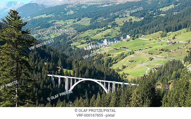 Alpine train at Langwies Viaduct, Swiss Alps, Switzerland