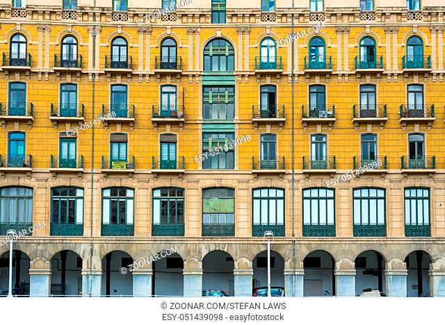 House facade in Bilbao at the Nervion river, that runs through the city. The apartment block is located in the San Frantzisko district of Bilbao