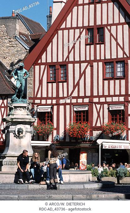 People at fountain in front of restaurant Place F. Rude Dijon Cote d'Or Burgundy France