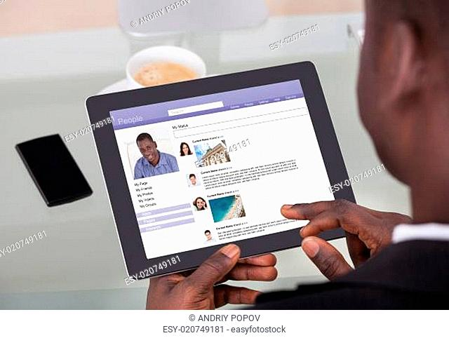 Businessman Chatting On Social Networking Sites