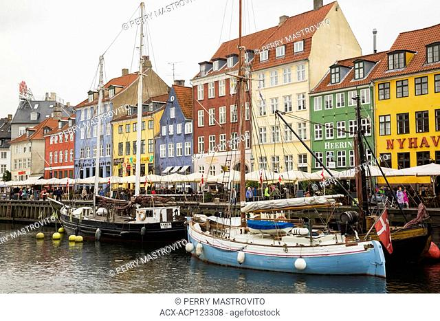 Colourful 17th century apartment buildings and houses with moored sailboats along the Nyhavn canal, Copenhagen, Denmark, Europe