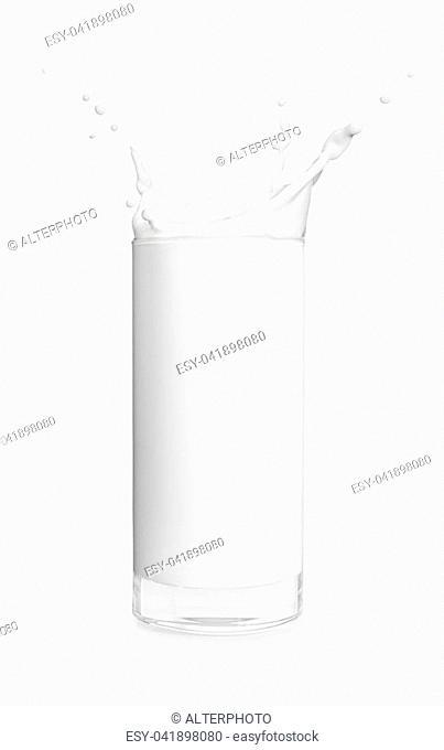 glass of milk isolated on white background. Milk splash. Pouring milk