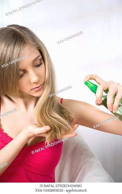 young woman applying hair conditioner