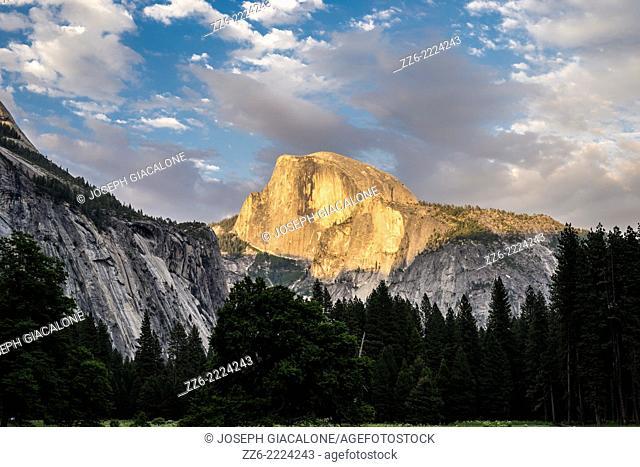 The setting Sun illuminating Half Dome. View from Yosemite Valley. Yosemite National Park, California, United States