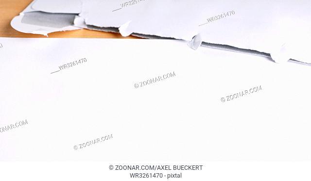 blank letter and opened envelope on desk