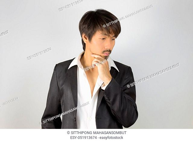 Portrait Businessman in Black Suit Fashion Touch Chin Pose. Portrait businessman wear white shirt and suit in smart pose style