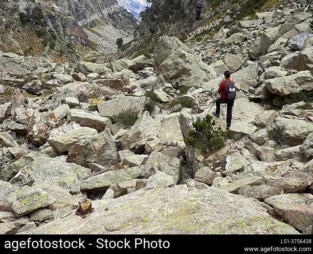Woman standing during a trek in Remuñe valley, Pyrenees, Benasque, Aragón, Spain