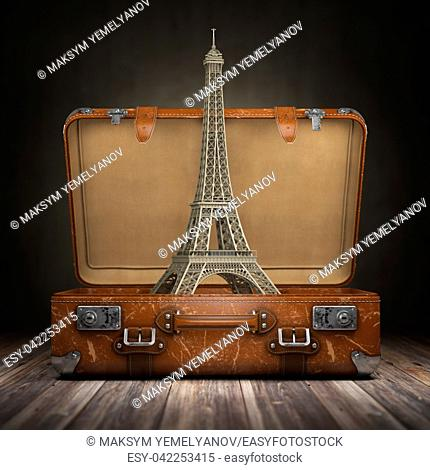 Trip to Paris. Travel or tourism to France concept. Eiffel tower and vintage suitcase. 3d illustration