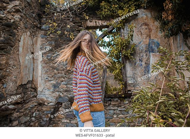 Young woman shaking her head at old sacral building