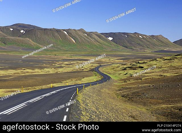 Empty Route 1 / Ring Road, winding national road in desolate barren landscape in summer at Austurland, East Iceland