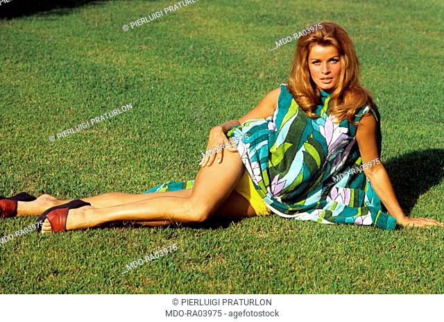 Austrian actress Senta Berger lying in the garden of her house in Hollywood. Hollywood, 1967