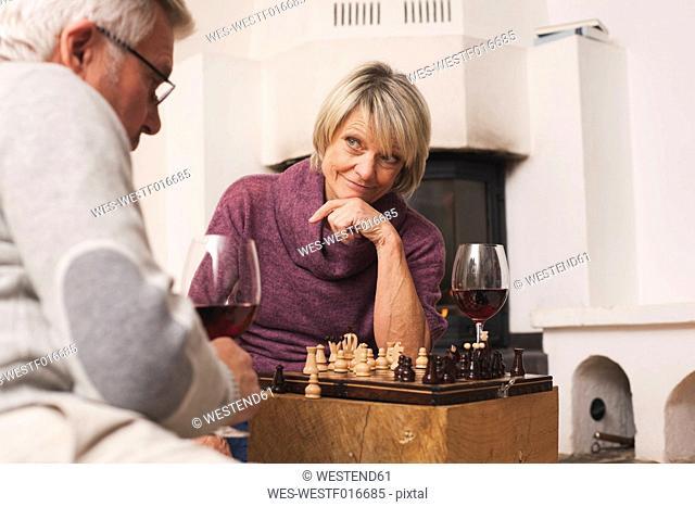 Germany, Kratzeburg, Senior couple playing chess board