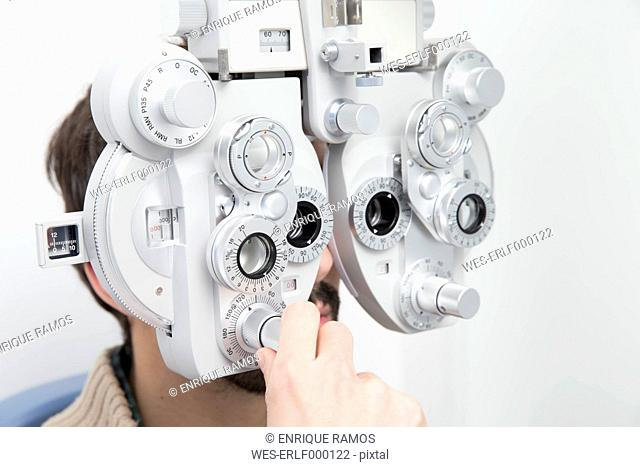 Man at the optometrist making an eye test