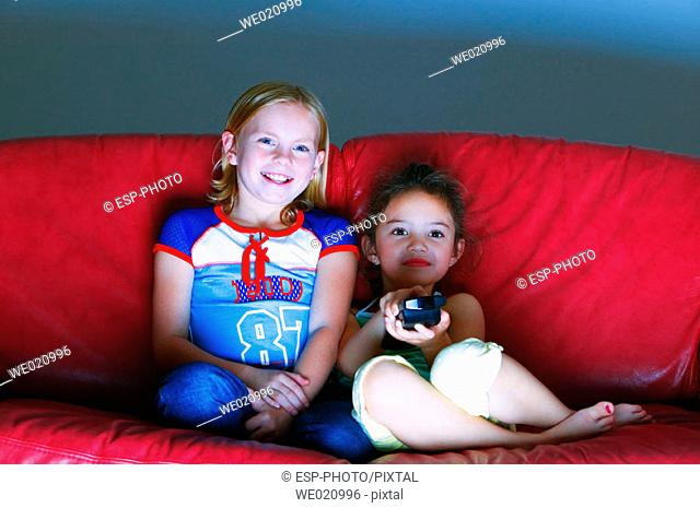 Young girls watching television