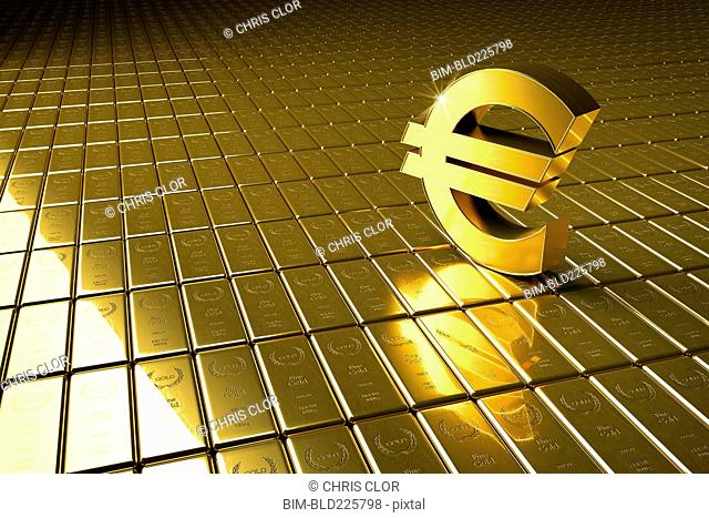 High angle view of gold bars and euro symbol