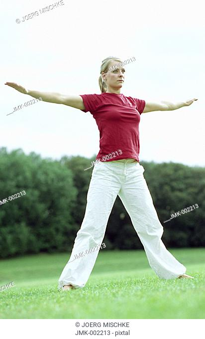 A young woman, 15-20 20-25 25-30 years old, practicing Yoga, Tai Chi, Qi Gong