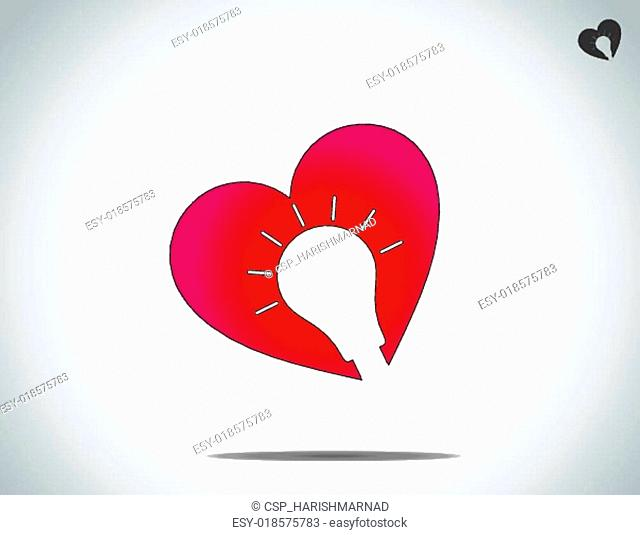 red heart with glowing light bulb