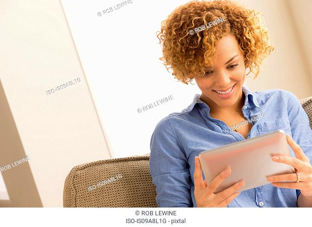 Young woman with electronic book