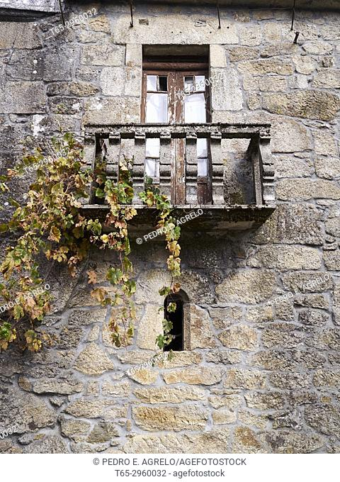 In the vineyards area, windows of an old stone manor house in the Ribeira Sacra, in a town near Montefaro, in Chantada, Lugo. Galicia, Spain