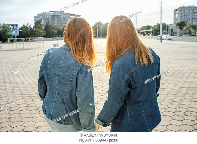 Redheaded twins in the city