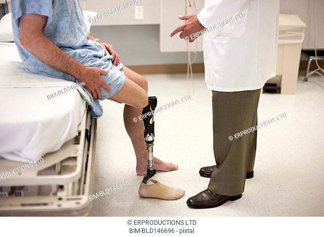 Doctor talking to patient with artificial leg