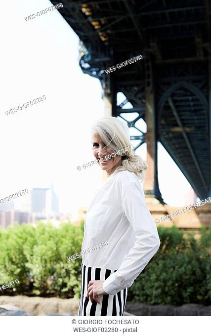 USA, Brooklyn, Dumbo, portrait of smiling woman