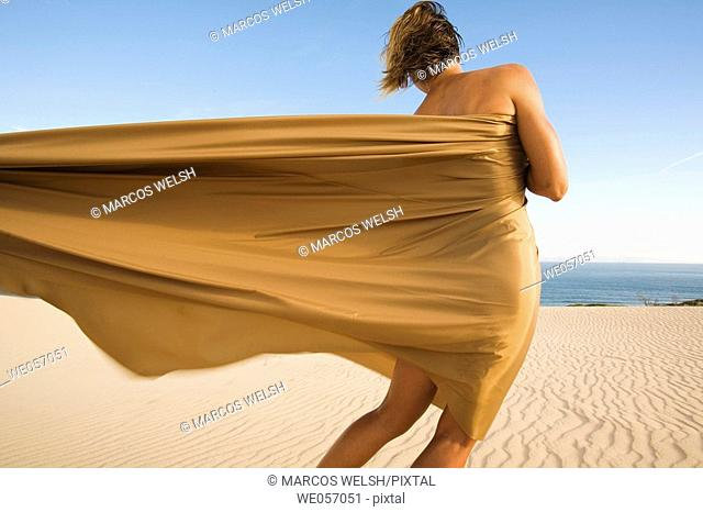 Woman With Gold Material