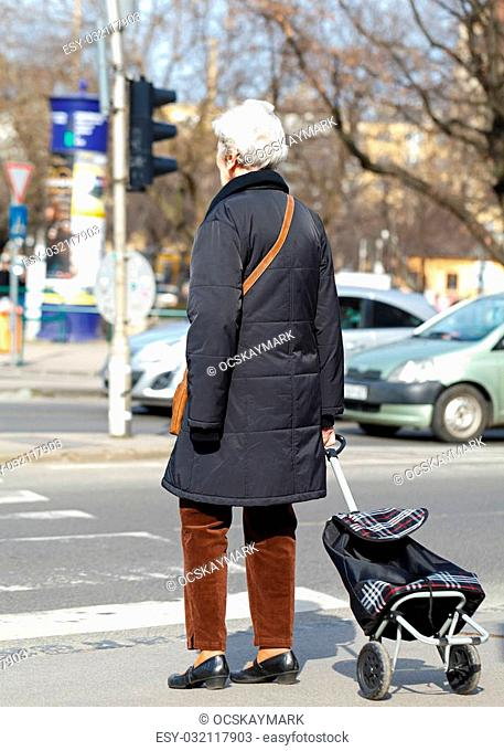 Senior woman waiting for crossing the street