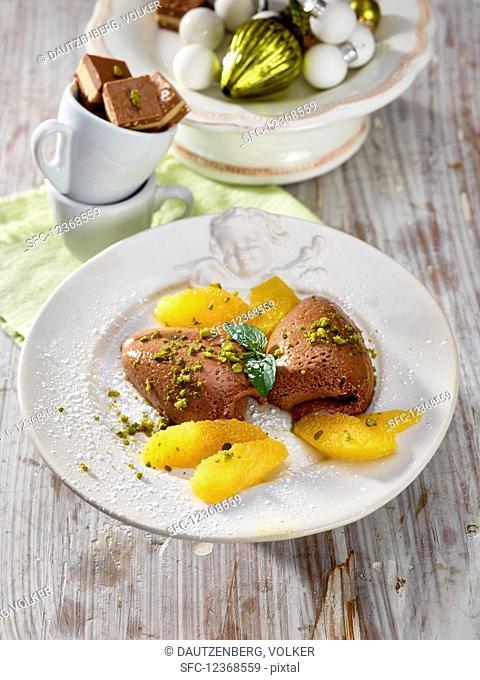 Praline mousse with orange fillets