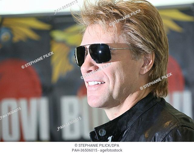 Singer Jon Bon Jovi poses for photographs before a press conference on his 'Because we can' tour, in Berlin, Germany, 28 January 2013