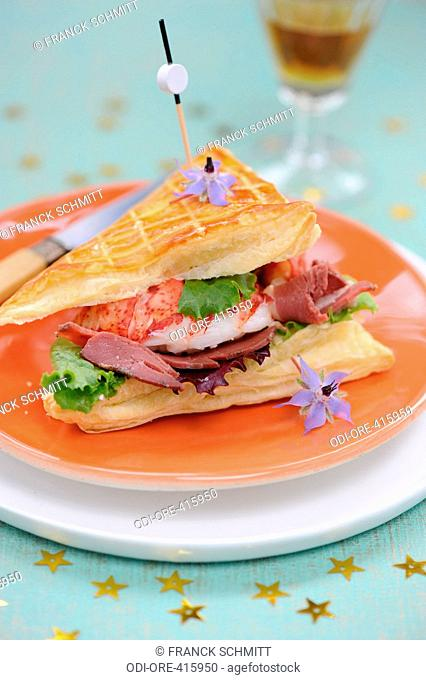Puff pastry with lobster and smoked duck fillet
