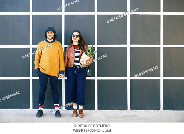 Young couple hand in hand